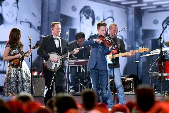 Sierra Hull, Justin Moses, and Carson Peters perform onstage during the 52nd annual CMA Awards at the Bridgestone Arena on November 14, 2018 in Nashville, Tennessee.  (Photo by Michael Loccisano/Getty Images)
