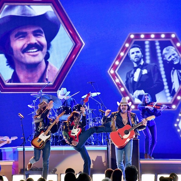 Jess Carson, Cameron Duddy, and Mark Wystrach of Midland perform onstage during the 52nd annual CMA Awards at the Bridgestone Arena on November 14, 2018 in Nashville, Tennessee.  (Photo by Michael Loccisano/Getty Images)