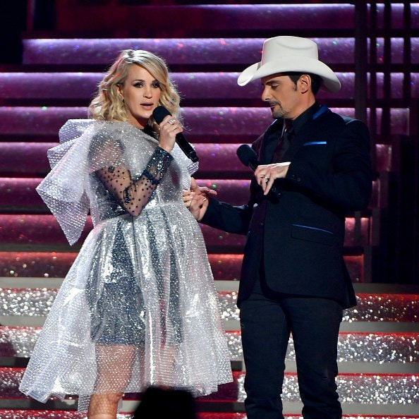 Brad Paisley and Carrie Underwood speak onstage during the 52nd annual CMA Awards at the Bridgestone Arena on November 14, 2018 in Nashville, Tennessee.  (Photo by Michael Loccisano/Getty Images)