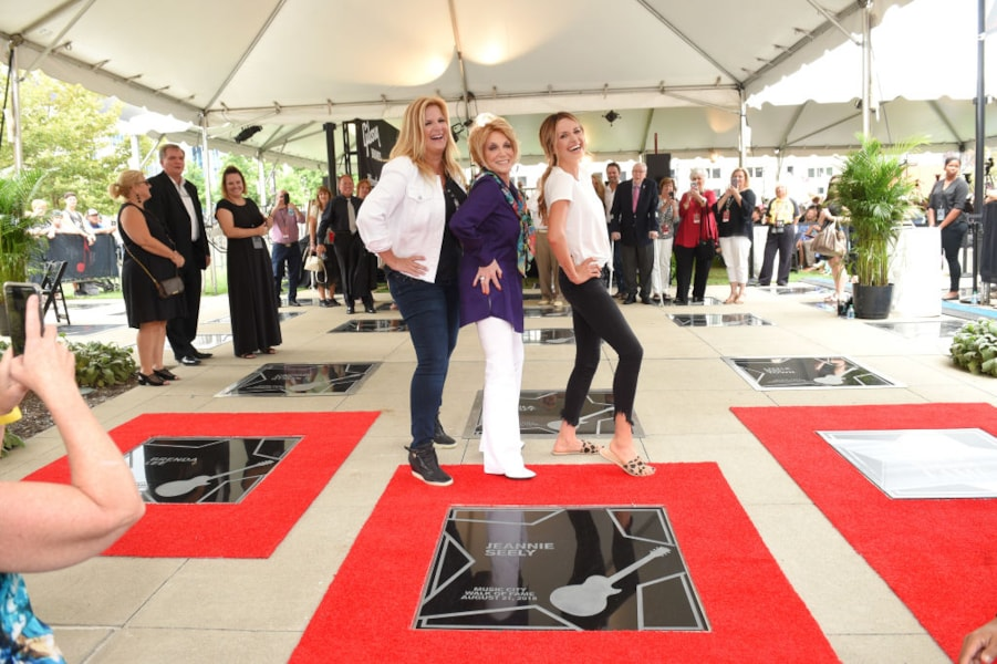 Trisha Yearwood, Jeannie Seely and Carly Pearce attend the 2018 Music City Walk Induction Ceremony at Walk of Fame Park on August 21, 2018 in Nashville, Tennessee.