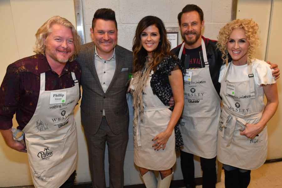 NASHVILLE, TN - APRIL 16: Little Big Town and Jay DeMarcus in the kitchen at the Waiting for Wishes Celebrity Waiters Dinner hosted by Kevin Carter & Jay DeMarcus on April 16, 2019 in Nashville, Tennessee. (Photo by Jason Davis/Getty Images for LEGACY Events)