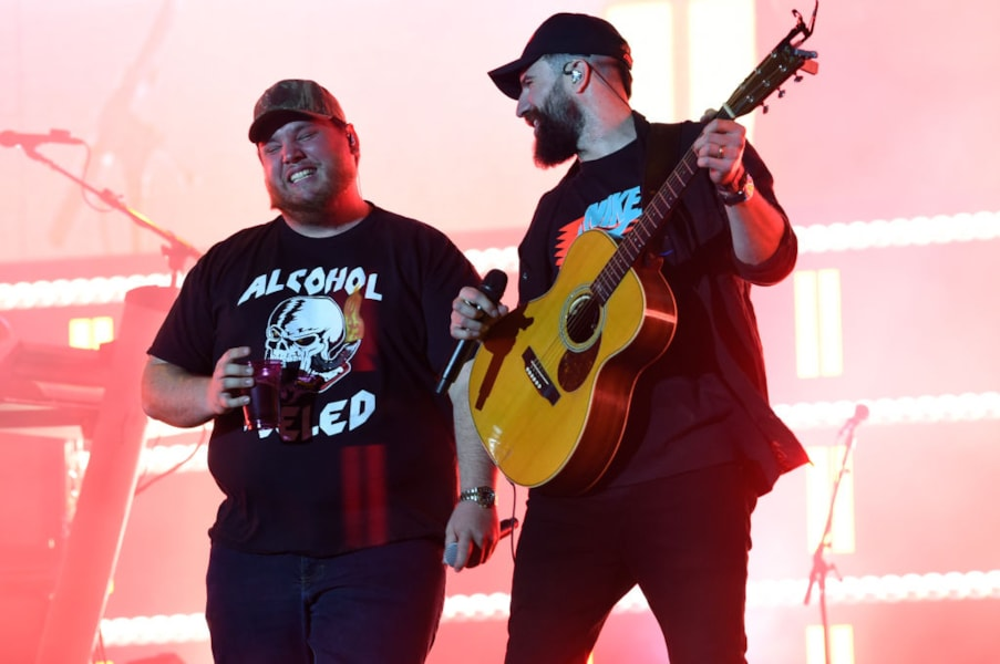 INDIO, CALIFORNIA - APRIL 27: (L-R) Luke Combs and Sam Hunt perform onstage during the 2019 Stagecoach Festival at Empire Polo Field on April 27, 2019 in Indio, California. (Photo by Kevin Winter/Getty Images for Stagecoach)