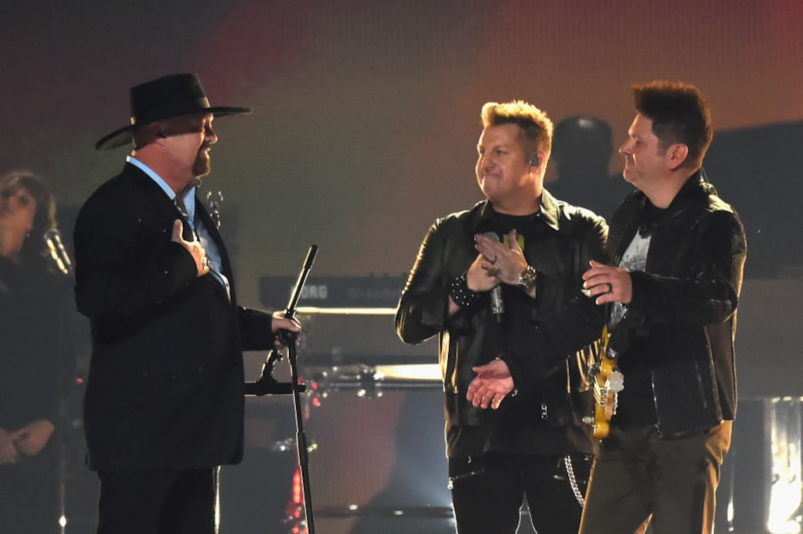 NASHVILLE, TN - NOVEMBER 08: Eddie Montgomery, Gary LeVox, and Jay DeMarcus perform onstage at the 51st annual CMA Awards at the Bridgestone Arena on November 8, 2017 in Nashville, Tennessee.  (Photo by Rick Diamond/Getty Images)