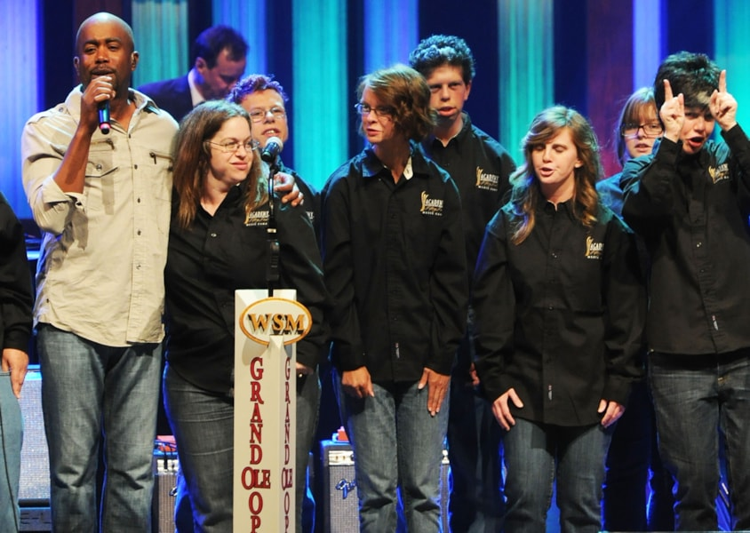 NASHVILLE, TN - JULY 01:  Singer/Songwriter Darius Rucker (white shirt) joins campers during  ACM Lifting Lives Music Camp Performance with DARIUS RUCKER at the Grand Ole Opry on July 1, 2011 in Nashville, Tennessee.  (Photo by Rick Diamond/Getty Images for ACM)
