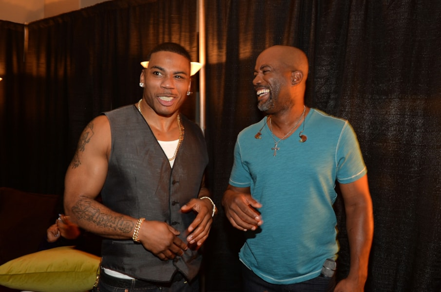 NASHVILLE, TN - JUNE 05:  Musicians Nelly and Darius Rucker attend the 2013 CMT Music awards at the Bridgestone Arena on June 5, 2013 in Nashville, Tennessee.  (Photo by Rick Diamond/Getty Images)