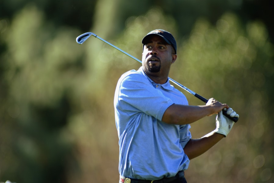 LA QUNITA, CA - JANUARY 30:  Rocker Darius Rucker from Hootie and the Blowfish hits a shot during the second round of the Bob Hope Chrysler Classic on January 30, 2003 at the La Quinta Country Club in La Quinta, California. (Photo by Scott Halleran/Getty Images)