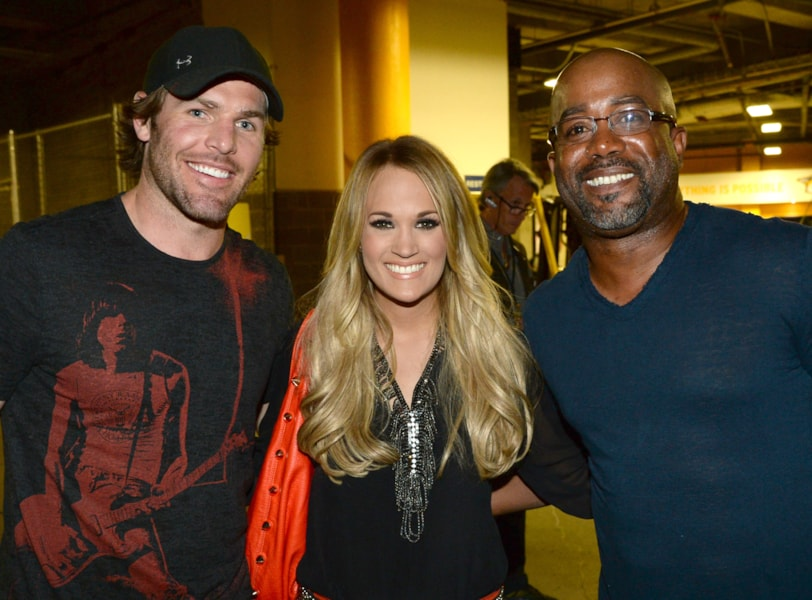 """NASHVILLE, TN - MAY 06: (EXCLUSIVE COVERAGE) The Nashville Predators' Mike Fisher, Carrie Underwood, and Darius Rucker attend Keith Urban's Fifth Annual """"We're All 4 The Hall"""" Benefit Concert at the Bridgestone Arena on May 6, 2014 in Nashville, Tennessee.  (Photo by Rick Diamond/Getty Images for the Country Music Hall of Fame and Museum)"""